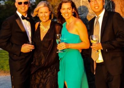 Four people dressed in formal attire at sunset attending an event supporting The Eustis Estate and Historic New England